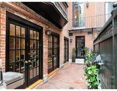painted french doors and red brick