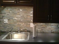 Stone look for backsplash along wall; perhaps different behind stove area. easy cleaning?