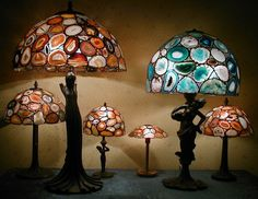 Line up the lamps. A stunning unique collection of handcrafted Agate table lamps. Created by Glass & Acht, distributed by Gemoholic. www.gemoholic.com  - POA