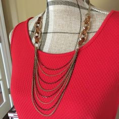 """Layer Necklace with Earrings Beautiful chain layer necklace has solid gold tone at top, then transparent style interlocking beads, varying brown and gold in color, then multiple gold and black tone hanging strands. No clasp, pullover style. Approximately 15"""" in length. The earrings mimic the second part of the necklace. Stylenu Jewelry Necklaces"""