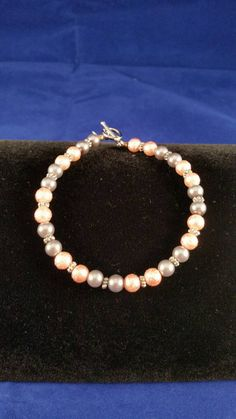 Hey, I found this really awesome Etsy listing at https://www.etsy.com/listing/251841666/mottled-pearl-grey-pearl-and-peach