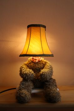 Lamp Bear, old teddy bear, old lamp shade, mood lighting, Led lighting, desk lamp... Punk Trek www.punktrek.com www.facebook.com/punktrek Old Teddy Bears, Brown Teddy Bear, Desk Lamp, Table Lamp, Old Lamp Shades, Fairy Lights, Lamp Light, Bobs, Trek