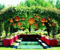 Orange Japanese lanterns greeted guests at this outdoor reception site.