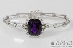 Bracelet, in the middle part esp framed with an amethyst v. diam.-diamonds total approx 1.1 cts TW-W/vsi-si. 14K WG. * Leg. 585/000 * Weight 20.6 g Starting Bid: € 720.00