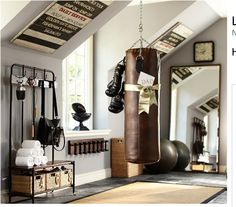 workout room - nice organization and use of angle ceiling...like the big floor mirror
