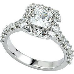 14K white gold beautiful engagement ring with a princess center stone set in a Halo setting.