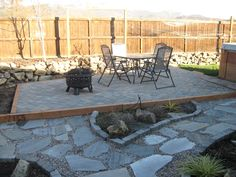 flagstone with pea gravel and framed brick (under the cover)
