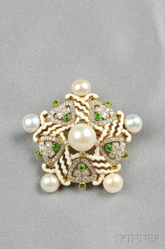 Edwardian 18kt Gold, Enamel, Demantoid Garnet, and Pearl Pendant/Brooch, designed as a starburst set with six pearls, white enamel highlights, and demantoid garnet and old European- and single-cut diamond accents, lg. 1 5/8 in.