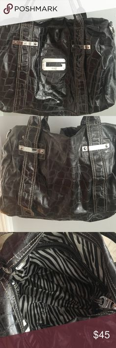Guess tote bag Dark gray tote bag. Inside is silky zebra. Guess Symbol on front GUESS Bags Totes