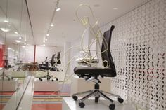 izzy+ NeoCon 2014 // Product shown: Wabi and Nikko chairs with our crazy wire sculpture friends.