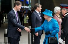 All smiles: The Queen beams as she is met by Heathrow's John Holland-Kaye and Colin Matthews June 23, 2014