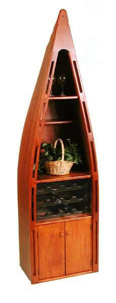 The Canoe Wine Center is made to replicate the style of an old wooden canoe, and it is a real conversation piece. It includes 3 shelves, an insert rack for storing 12 wine bottles, a two door cabinet, and casters for easy movement. This rustic piece would be perfect in a family room with a pool table, or at your lodge in the country.