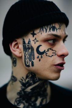 Closeup of man with face tattoos