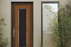 db-a30m Aurora fiberglass doors are made to look and feel like solid wood, without any of the maintenance. Craftsman style door shown is displayed with two full glass sidelights, and decorative glass.