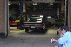 Street of dreams: Putting the Hemi away for the night. With bonus Gary action.