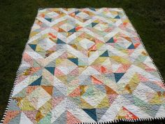 Same blocks, different layout of the blocks.  I could do this with 3 groups of fabrics.