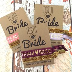 "Team Bride Bachelorette Party Favors are the perfect addition to your goody bags for your girls night out. Each set comes with one ""team bride"" hair tie and one gold glitter hair tie. Choose your ""tea"