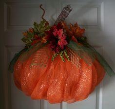 Pumpkin Wreath with Deco Mesh!  Learn how to make it here...  http://blog.mardigrasoutlet.com/2011/08/diy-pumpkin-door-decoration-with-deco.html