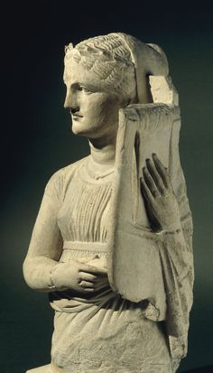 Limestone statue of a female lyre-player in Greek dress. Her features resemble those of Berenice I.