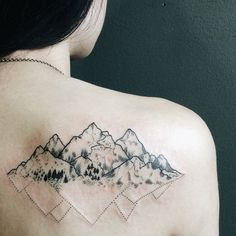 This ones shows a back mountain tattoo with two sides: one shows roughness and details, while the other is a simple outline that is smooth and even. It could also mean your two sides.