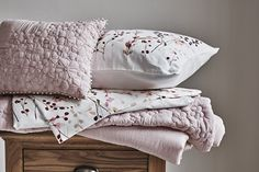 From our exclusive RJR.John Rocha range, this stylish throw will effortlessly complement any bedroom interior with its light pink pinched flower design. Finished in irresistibly soft cotton, co-ordinate with matching bedding for the perfect finishing touch.