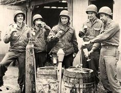 Drinks of War _______________________________  GI's of the 9th Army enjoy some captured Schwartzbier in a Biergarten in Germany. Leaning up against the kegs is a captured Panzerfaust 60. -------------