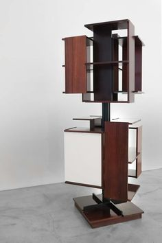 Revolving book shelf designed by Claudio Salocchi Made from rosewood it  was produced by Sormani of Italy in