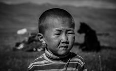 A nomad child from Tien Shan Mountains Kyrgyzstan.  This place is a plateau on top of this mountain range. This nomad kyrgyz child's photo is one of my ptoho projects portrait series.