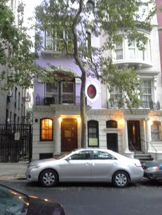 purple house in NYC, upper west side, 101st. can see color changing light show at night.