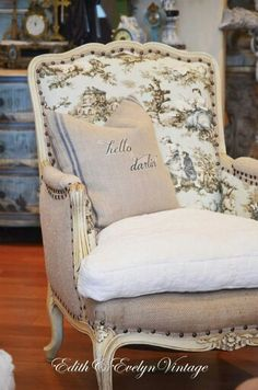 French bergere chair reupholstered in antique grain sack, burlap and toile. … French bergere chair reupholstered in antique grain sack, burlap and toile. More antiques market Poltrona Bergere, Bergere Chair, French Country Bedrooms, French Country House, European House, French Cottage, French Decor, French Country Decorating, French Chairs