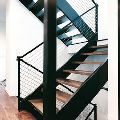 We keep working on our open tread stairs with cable railing in our new dark exterior modern farmhouse. We're a DIY husband and wife that love building projects together! @leahschmidtreinert Down Leah's Lane