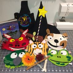 Room on the Broom story sack. Includes: board book, wand, hat (with long ginger plait attached), cauldron, masks for each animal, a lily, a cone, a stick and a bone.