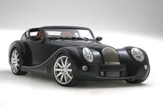 morgan-motor.co.uk for more yumminess.  Handmade, frame made of ash.  As in, the Ash tree.  Yep, wooden frame.  No.  Kidding.  Simon Cowell apparently owns the only one in the US.  Go figure.