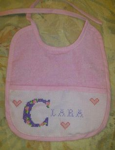 Bib I made.  I personalise them for $9.95. They can be done in pink, blue, pale green, pale yellow or white with any personalisation.