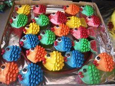 Rainbow Fish Cupcakes Just your favorite cupcake recipe, some food coloring for the frosting and some m & m's or skittles!! This may not look like a valentine to you, but my husband loves to fish, and he also loves M's/Skittles. Have to make these for his birthday!