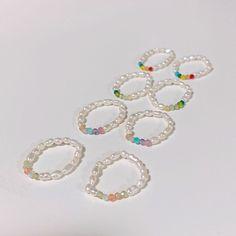 """문릿(moonlit) official(@moonlit.acc)向 Instagram 帐户添加了照片:""""진주 #비즈반지 💛 #한정수량"""" Diy Wire Jewelry Rings, Diy Beaded Rings, Bead Jewellery, Cute Jewelry, Beaded Jewelry, Jewelery, Jewelry Accessories, Handmade Jewelry, Jewelry Making"""