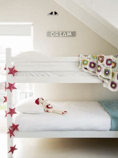 What a sweet kids room - clean colours with pops of colour