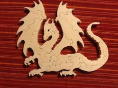 Dragon scroll saw puzzle made from aspen