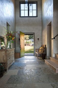 Summer style!! Modern Rustic foyer front entrance front door! LOOk at the gorgeous finish on the walls and floor!