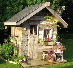 Salvaged Wood Garden Shed made of recycled materials. By Laurie Ceesay, artsychickquilts.blogspot.com