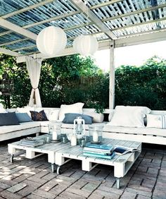 Outdoor patio on a budget. furniture made of pallets topped with cushions add pillows and some cheap paper lanterns to make it look rustic chic.....i will definately try this in my next place!