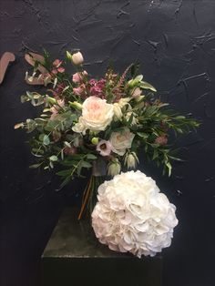 Unstructured Bridal bouquet with O'hara roses, Sweet Avalanche roses, lisianthus, white Blushing Bride flowers, astrantia, wax flowers, astilbe flowers, tissel, eucalyptus, soft ruscus.