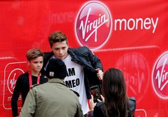 Brooklyn Beckham Photos Photos - Romeo Beckham (L)  poses for a photo with his brother Brooklyn Beckham (R) after taking part in the junior marathon during the Virgin Money London Marathon on April 26, 2015 in London, England. - Virgin Money London Marathon