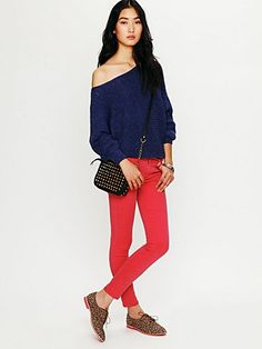free people: horizontal rib marled sweater and red seamed skinny jeans. $128.00 for both.