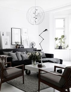 Black and white living room with wooden chairs.