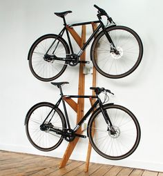 Branchline is a stylish piece of furniture that displays up to two bikes with space efficiency. Two sets of adjustable arms can accomodate a variety of bike frames. The stand can be leant against any wall or inverted to clear floor area in smaller spaces.Made exclusively in England using FSC certified Bamboo and hand-finished in leather.   www.quarterre.com