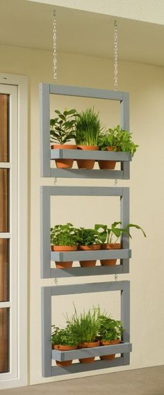 Idea For Hanging Vertical Frames For Small Potted Herbs