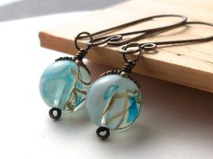 Antiqued brass aqua blue glass beaded earrings
