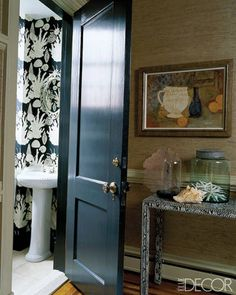 The foyer's faux-python console was bought on eBay; the powder room features Lulu DK wallpaper.   - ELLEDecor.com