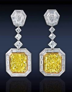 Two GIA certified Ct. Fancy Intense Yellow Radiant Cut Diamonds Mounted In Yellow Gold, Surmounted By Ct. Square Emerald Cut Diamonds GIA Certified) And Ct. Trapezoid Cut Diamonds, Framed by Ct. Baguette Cut Diamonds, Mounted In Platinum. High Jewelry, I Love Jewelry, Jewelry Design, Jewellery, Ladies Jewelry, Yellow Jewelry, Diamond Earrings, Diamond Jewelry, Drop Earrings